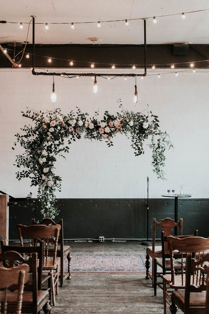 Gorgeous rose garland installation over the ceremony space   Image by Karra Leigh Photography