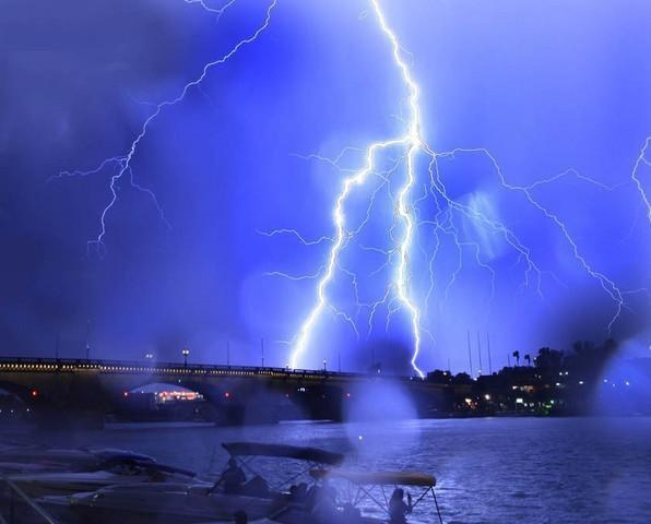 July 2012 we've seen a tremendous amount of monsoon storm activity. Here's a tremendous shot of lightning over the London Bridge.  Lake Havasu City, Lake Havasu,