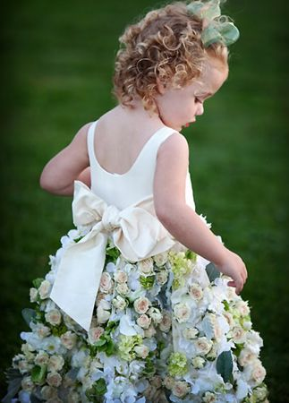 A Flower Girl Dress Made With Real Roses