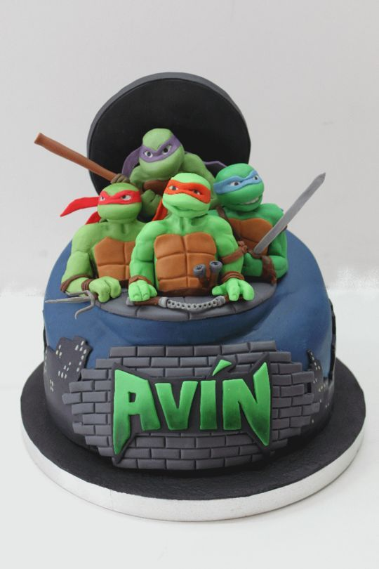 Ninja Turtle Cake - A sweet little boy wanted a ninja turtle cake for his birthday sooooo his mum did us the honour of making his wishes come true by asking us to make the cake. Everything but the base is edible!