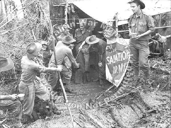 """""""Jonno's Jungle Joint"""", Shaggy Ridge, New Guinea with troops of the 2/9th Infantry Battalion"""