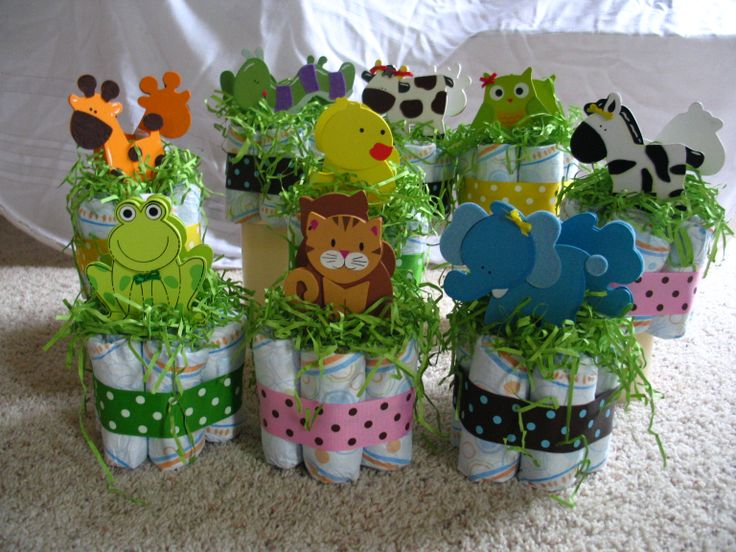 Take diapers, wrap with a cute ribbon, tuck in Easter grass and add a cute pair of animals. Cute centerpieces for baby shower. @Anna Totten Martin