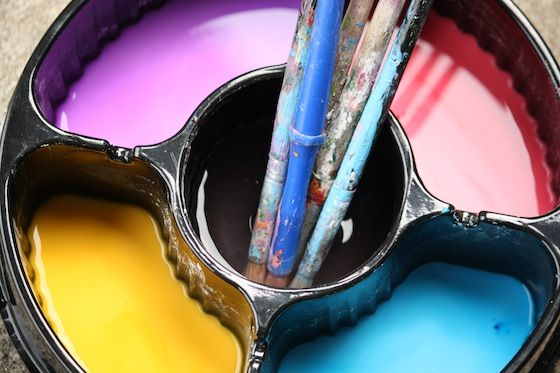 mix sidewalk paint in a sectioned container to make using it easy and accesible to all.