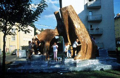 Thomas Hirschhorn, Bataille Monument, 2002, Kassel, Documenta 11. Several critical approaches: http://www.installationart.net/Chapter3Interaction/interaction03.html  , in Artforum Feb. 2006,p 181, Claire Bishop's article  'The Social Turn: Collaboration and Its Discontents' http://www.gc.cuny.edu/CUNY_GC/media/CUNY-Graduate-Center/PDF/Art%20History/Claire%20Bishop/Social-Turn.pdf and http://uk.phaidon.com/agenda/art/articles/2013/may/07/thomas-hirschhorns-gramsci-monument-in-nyc/