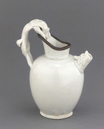 Ewer with iron-shaped handle late 8th-9th century Tang dynasty Porcelain with transparent ivory-toned glaze; copper repair H: 15.1 W: 12.1 cm China