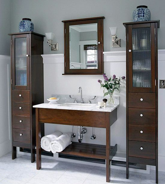 Narrow wooden cabinets to put on both sides of the bathroom sink.
