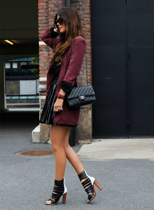 Shop this look on Lookastic:  http://lookastic.com/women/looks/sunglasses-trenchcoat-button-down-blouse-crossbody-bag-mini-skirt-heeled-sandals/8412  — Black Sunglasses  — Burgundy Trenchcoat  — Black Button Down Blouse  — Black Quilted Leather Crossbody Bag  — Black Pleated Leather Mini Skirt  — Black and White Leather Heeled Sandals