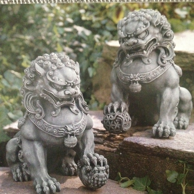 """Foo Dogs: Half dog, half lion, the mythical Foo dog appears as a temple guardian in China. This pair of Foo dogs adds family protection for a home. An unusual housewarming or wedding gift. Hand-painted polyresin. 6""""W x 11""""H x 11 1/2""""L. $79.95 from www.winterthurgifts.com."""