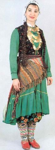 Turkish folkloric costume, only worn at performances or special events. It is different colors with a lot of jewelry on it