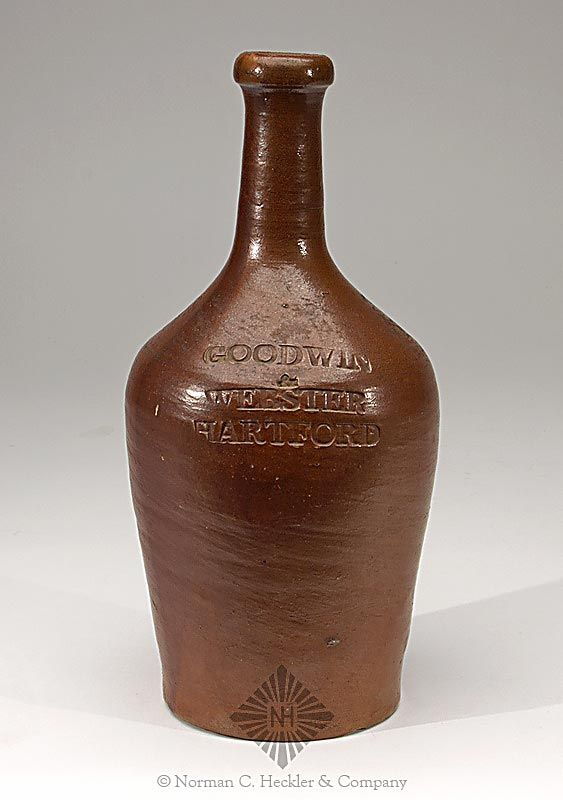 """""""Goodwin / & / Webster / Hartford"""" Stoneware Bottle, Goodwin and Webster Pottery Works, West Hartford, Connecticut, 1818-1830. Ovoid form, gray with brick red glaze, tooled round collared mouth - smooth base, ht. 9 3/4 inches; (usage wear and roughness on base edge). Early and unusual form. Fine condition. #Bottles #Antique #MADonC"""