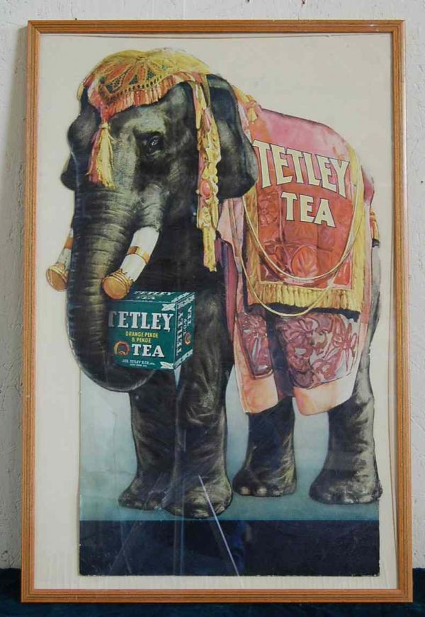 FRAMED TETLEY TEA AD WITH ELEPHANT, ca. 1930.   Lithograph on pasteboard in brilliant colors.