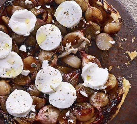 This shallot tart tat in has become the go-to starter for most lunch or dinner guests for the past year. Since we grow way too many shallots over the winter, it's the best way to celebrate the harvest. Jared adds a special touch: Lightly grill the slices of goat's cheese under the broiler before service.
