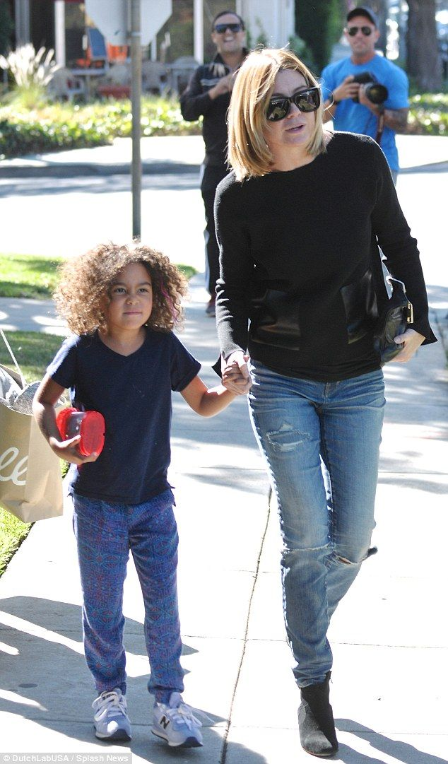 Cool threads: Her daughter Stella kept it casual in a blue hued ensemble, with purple pink coloured strands in her hair
