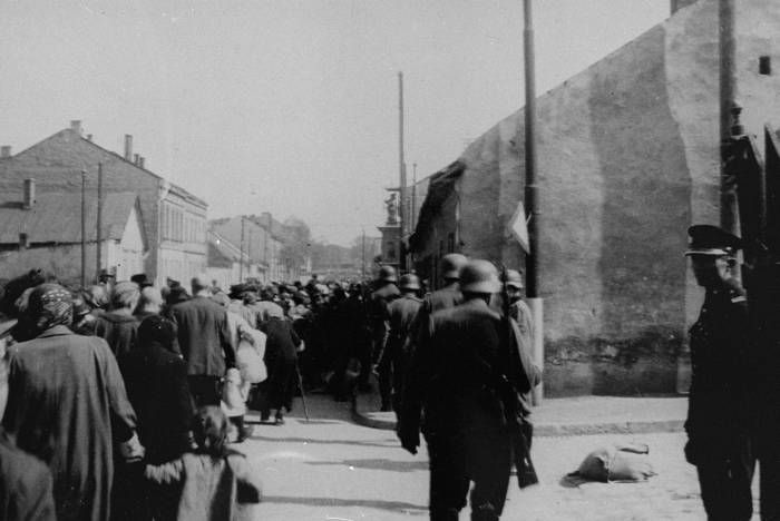 A column of Jews forced to march through the streets of Krakow during the final liquidation of the ghetto. Krakow, Poland, 1943. Almost all will be sent to gas chambers and a few selected for slave labor and a slow death. Few will survive.