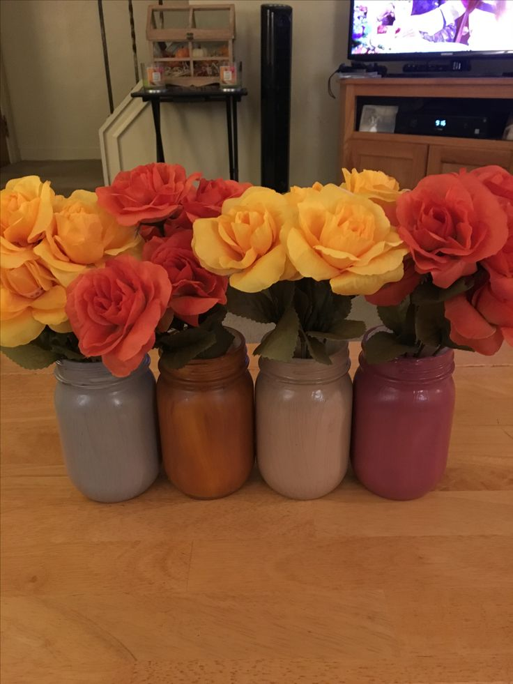 Kerr mason jars painted with Martha Stewart paints