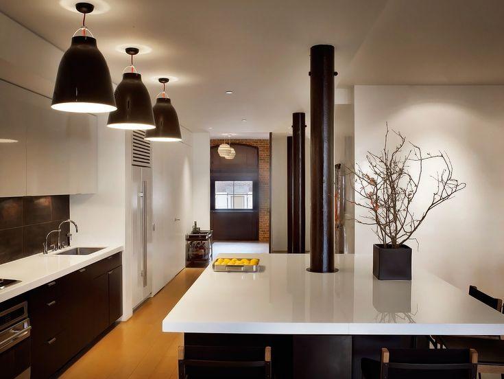 loft kitchen: dark cabinets + white countertops