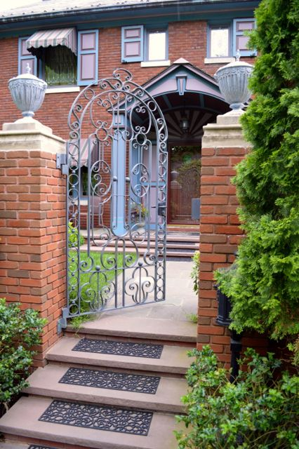Beautiful gated entry with brick columns and ornate iron for Brick and wrought iron fence