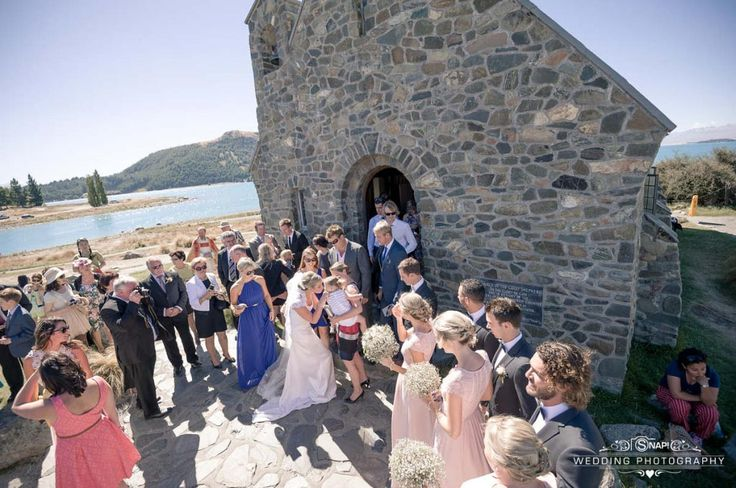 Guests congratulating the bride at the Church of the Good Shepherd, Lake Tekapo. Check out other wedding photography by Anthony Turnham at www.snapweddingphotography.co.nz
