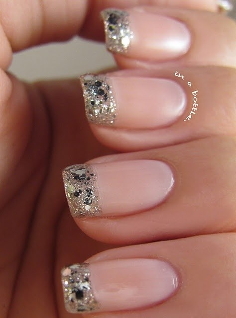 "Glitter French Manicure ~ Base: Essie ""Vanity Fairest"" {or Orly ""Deja Vu""} - French Tip: OPI ""Crown Me Already!"" {or Orly ""Tiara""} *looks best with a thin coat of metallic silver on tips as base*"