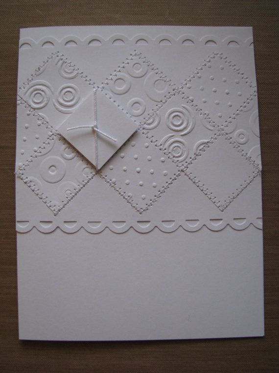 embossed all white handmade greeting card with sewn