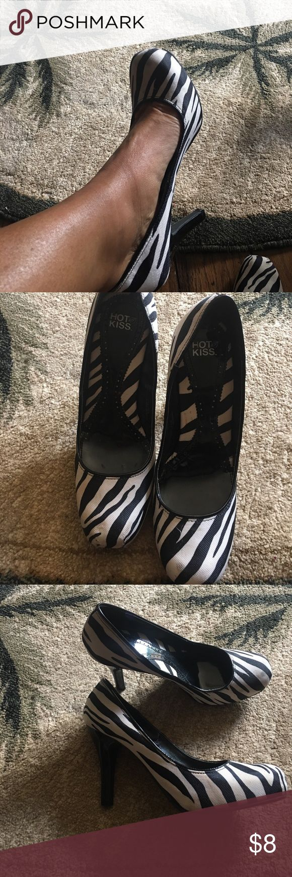 Fun zebra shoes Cute and fun with black dress or pants. Still plenty of wear left in these cute shoes. A couple of light stains.  You could try to clean up but not noticeable Hot Kiss Shoes Heels
