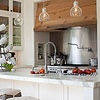 Rustic and modern elements, love the lights and the pot filler faucet.
