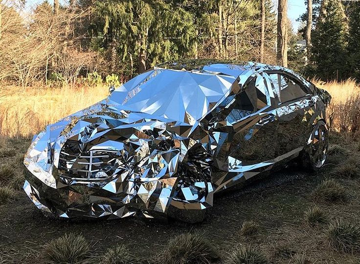 """""""Wreck"""" by Jordan Griska // Life-size sculpture """"Wreck"""" by Jordan Griska is a perfect replication of a Mercedes Benz S550 car constructed from thousands of polished steel mirrors. The Brooklyn-based artist echoes the themes of F.S.Fitzgerald's Gatsby juxtaposing the efflorescence of luxury with brutality of wreckage  @jordangriska"""