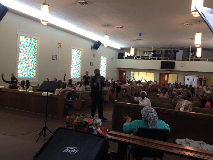 Pasteur Reno singing in Jeune de la foi prayer meeting at Eglise Nouvelle vie.