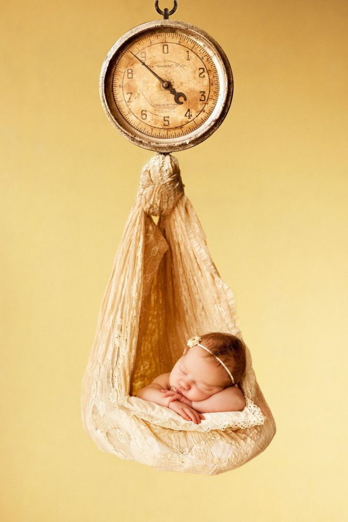 Newborn Photos by Jo Frances Wellington, Award Winning Photographer - Adorable, colourful photo of a newborn baby, in vintage scales, by Jo Frances