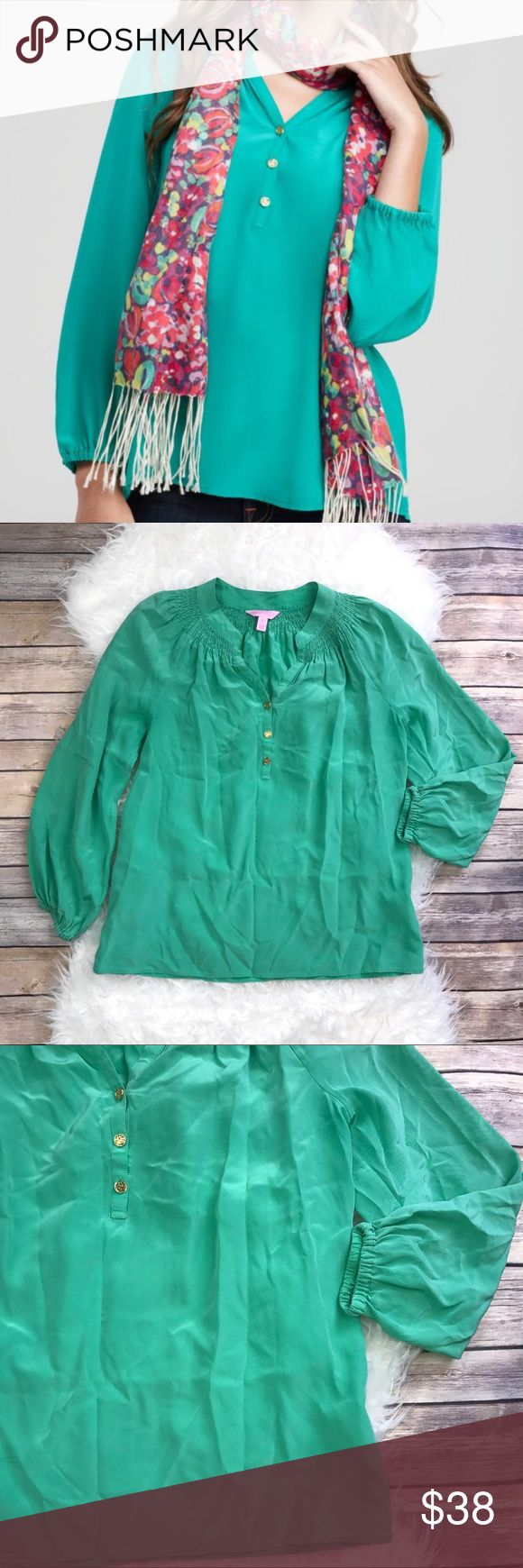 """Lilly Pulitzer Silk Elsa Top Excellent condition Lilly Pulitzer Green Silk Elsa Top. Size XS. Smocked around the collar, long sleeves, gold logo buttons. 100% Silk. Elastic cuffs. Soft grass green. Bust 38"""", length 25"""", long sleeves. No trades, offers welcome. Lilly Pulitzer Tops Blouses"""