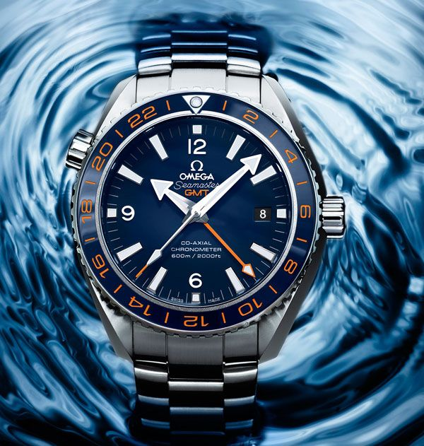 Omega Seamaster Planet Ocean GoodPlanet GMT Watch - Love this with the navy blue and orange!  Virginia Cavaliers colors.