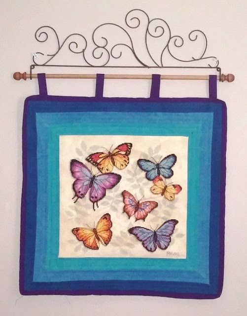 """Wall hanging made from completed cross stitch project. The project is Butterfly Profusion by Dimensions. Finished size: 17"""" x 17 """""""