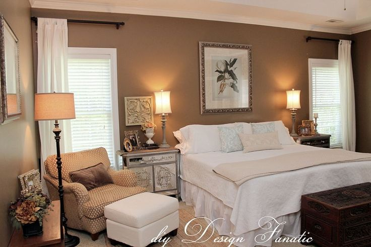 Decorating A Master Bedroom On A Budget Window Corner Window Curtains And Chair And Ottoman