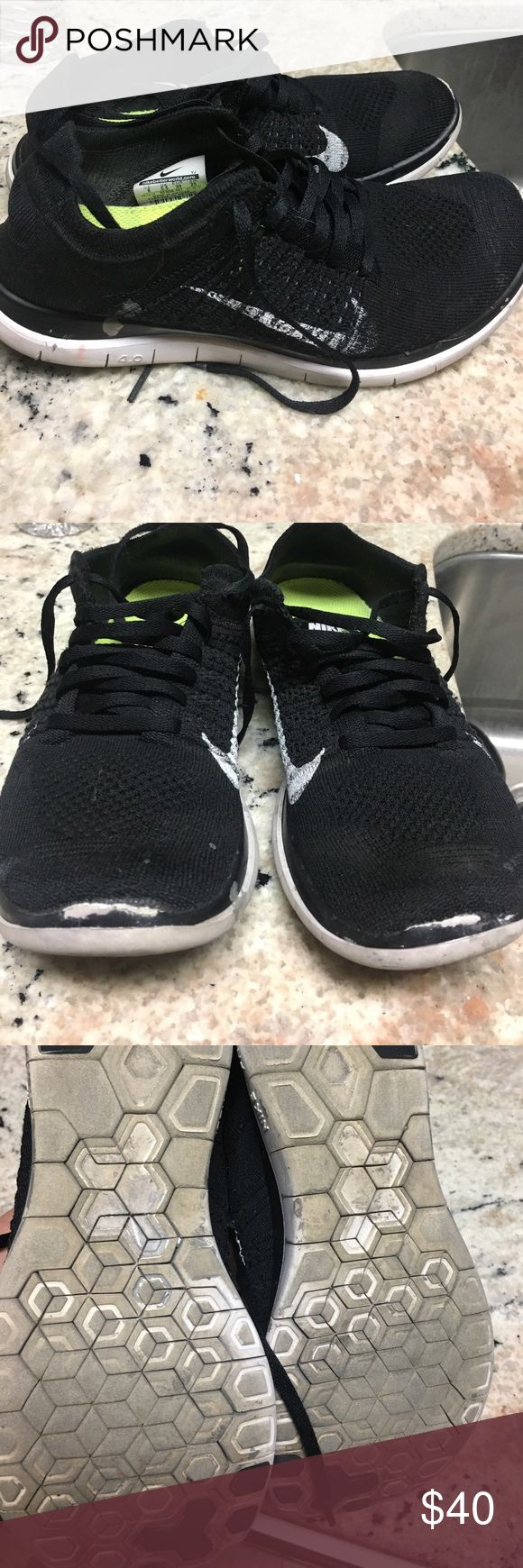 Nike flyknit black women size 8 See pics. Have been worn but still lots of life left. Black. Size 8. See scuff on toes. See paint mark on bottom Shoes Athletic Shoes
