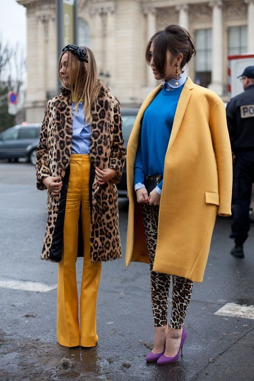 Dress in a mustard coat and tan leopard leggings for a refined yet off-duty ensemble. Elevate this ensemble with purple suede pumps.  Shop this look for $115:  http://lookastic.com/women/looks/dress-shirt-crew-neck-sweater-clutch-coat-leggings-pumps/4370  — Light Blue Dress Shirt  — Blue Crew-neck Sweater  — Navy Leather Clutch  — Mustard Coat  — Tan Leopard Leggings  — Purple Suede Pumps