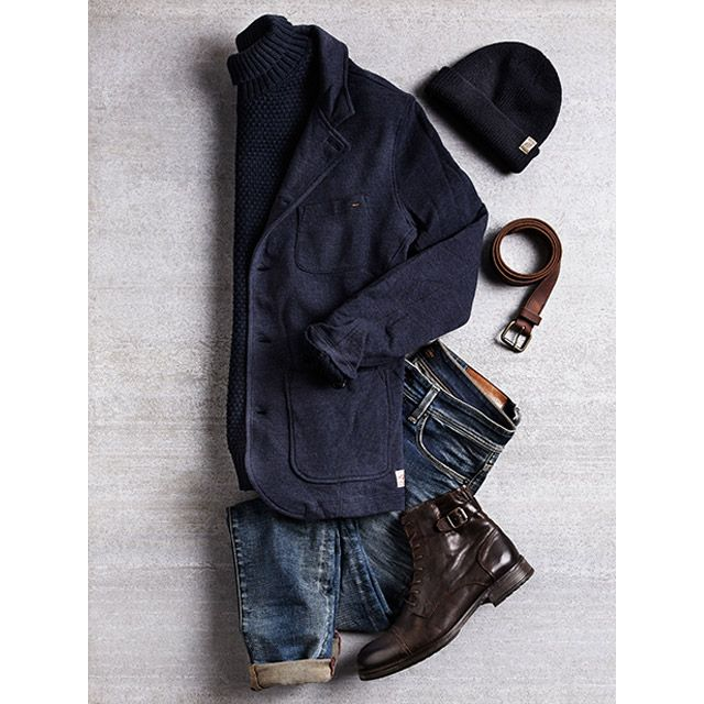 Winter to spring transition outfit idea for men: blue sweat blazer, blue beanie, dark blue turtle neck, distressed blue denim jeans, dark brown leather boots and a brown leather belt | JACK & JONES