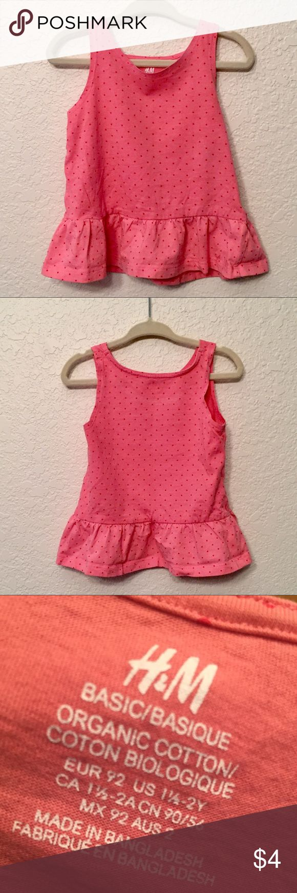 Toddler Girl Pink Peplum Top Cleaning out the daughter's closet. This H&M top is so darling and, while it has been washed and worn, it has maintained perfect condition. It's 100% cotton and did not shrink or warp at all with regular care. H&M Shirts & Tops Tank Tops