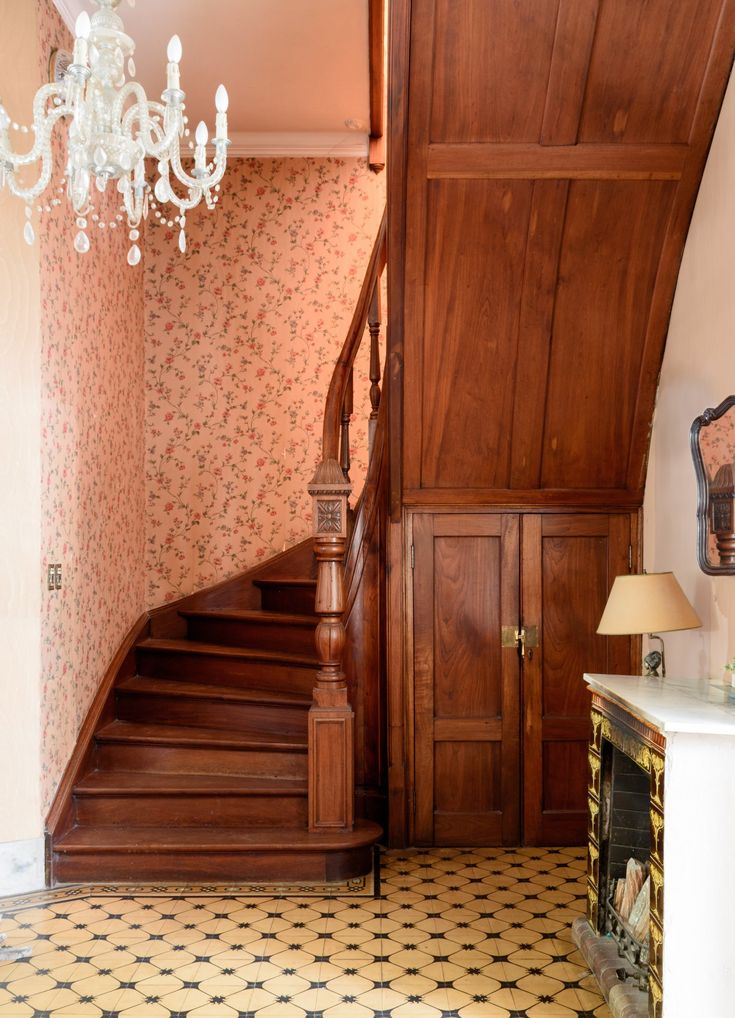 They love the original wallpaper sorrounding the staircase but it needs to be replaced. Should they just paint? Install new wallpaper? They're open to suggestions in the tour's comments!