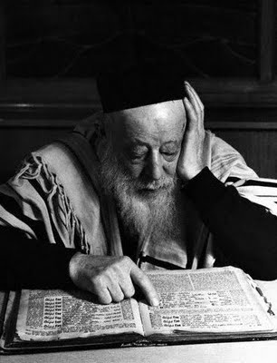 Rabbi studying the Zohar