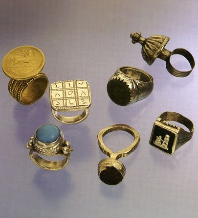 Africa | A collection of rings from the Oromo people from Ethiopia and Sudan | gold silver and glass beads | 20th century.