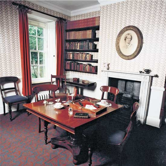 """Writers' Rooms: Charlotte Brontë. This is the room in Haworth Parsonage, variously known as the dining room, the drawing room or the parlour, in which the Brontë sisters used to write and discuss their work with each other."" Click through for much more biographical information."