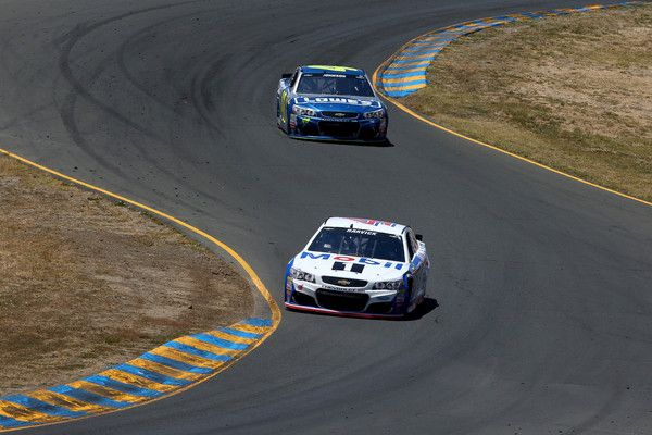 Jimmie Johnson Photos Photos - Chase Elliott, driver of the #24 3M Chevrolet, races Jimmie Johnson, driver of the #48 Lowe's Chevrolet, during the NASCAR Sprint Cup Series Toyota/Save Mart 350 at Sonoma Raceway on June 26, 2016 in Sonoma, California. - NASCAR Sprint Cup Series Toyota/Save Mart 350