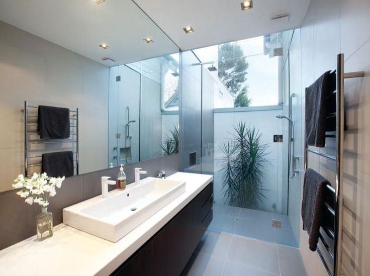 Photo Of A Modern Bathroom Design With Floor To Ceiling Windows Using Frameless Glass From The Bathroom Galleries Bathroom Photo Browse Hundreds Of Images