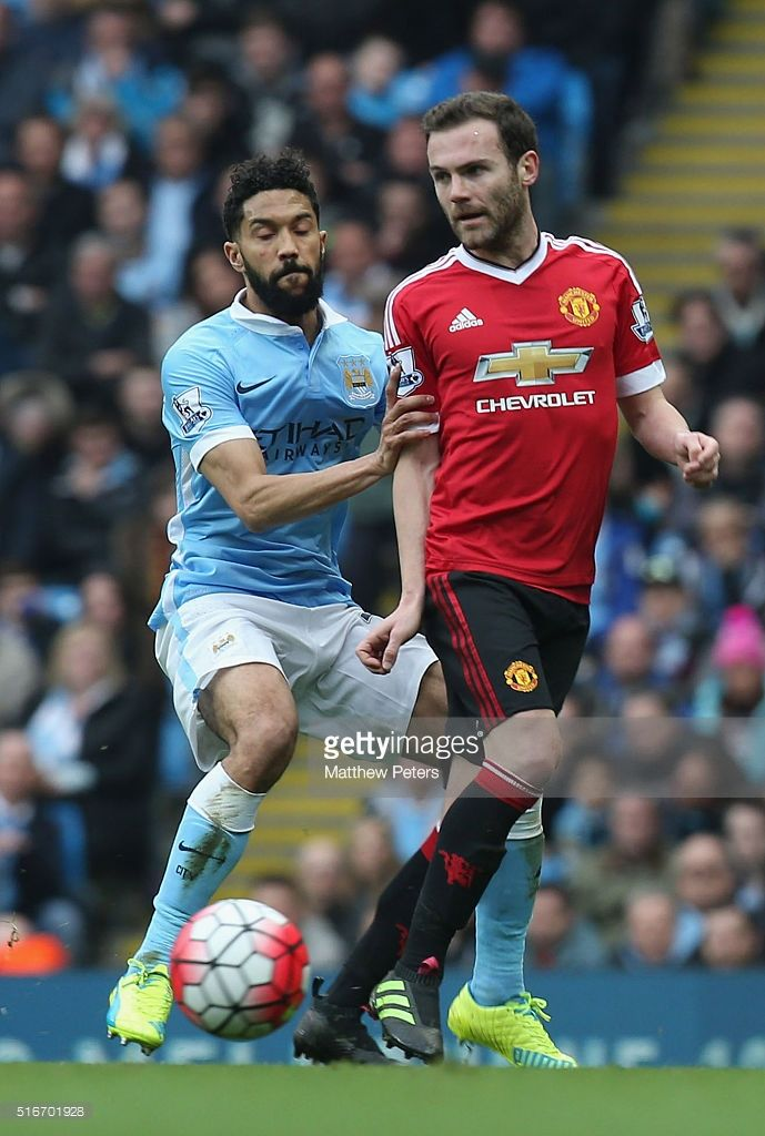 Juan Mata of Manchester United in action with Gael Clichy of Manchester City during the Barclays Premier League match between Manchester City and Manchester United at Etihad Stadium on March 20, 2016 in Manchester, United Kingdom.