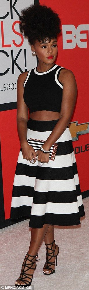 Showing some skin: Janelle Monae showed off her toned midriff in a black and white two-pie...