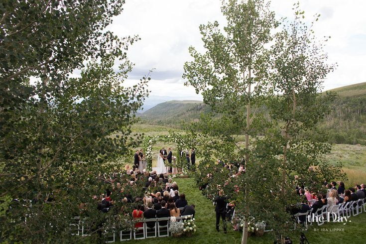 Backyard wedding ceremony in the Rocky Mountains. Photo by The Day Collective