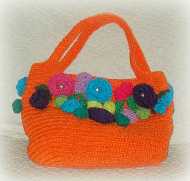 BORSA CON FIORI COLORATI Borsa arancione in cotone con fiori colorati applicati