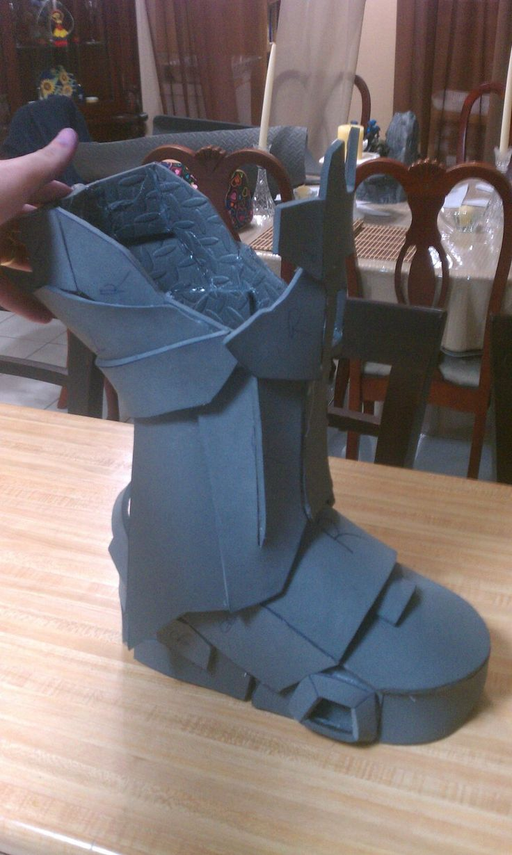 Though these boots are sci-fi the concept could easily work for LARP gear. This series of pics is quite helpful. - eva foam armor halo reach custom shin armor 7 by silvereyedsurfer on DeviantArt