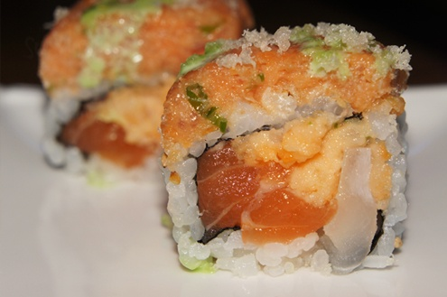 Spicy Girl Roll: spicy white tuna, red snapper, salmon and tempura flakes inside. It is then topped with a giant heap of spicy tuna and drizzled with tempura flakes and wasabi mayo.