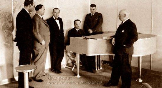 LZ129 Hindenburg Franz Wagner Piano, with Dr. Rudolf Blüthner-Haessler to his left in the corner, and Captain Ernst Lehmann to his right. Photo courtesy Julius Blüthner Pianofortefabrik.